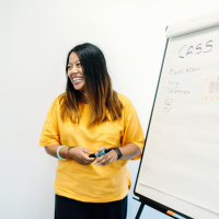 Colleague writing on a whiteboard
