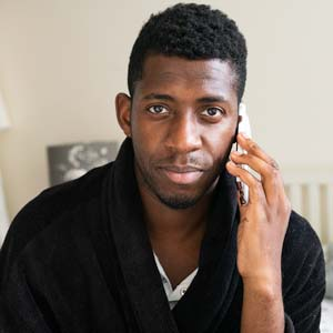 Man on the phone looking at the camera