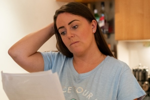 worried woman reading paperwork